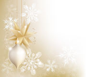 Gold snowflake and Christmas bauble background. A gold snowflake and Christmas bauble decoration background with hanging ornaments, abstract snow flakes and Royalty Free Stock Photo