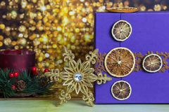 Gold snowflake with gift box on glitter background Royalty Free Stock Photography