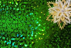 Gold snowflake on green Royalty Free Stock Photography