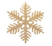 Gold snowflake isolated on white background. Close up Royalty Free Stock Image