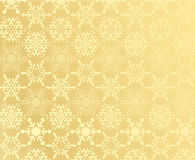 Gold snowflake pattern Stock Images