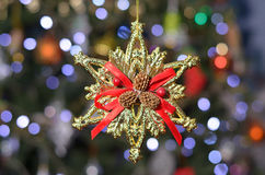 Gold snowflake with red bow Royalty Free Stock Photography
