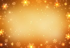 Gold snowflakes on golden background - luxury holiday decorated background. Snowflakes frame structure. Empty golden chic Stock Image
