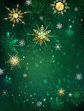 Gold snowflakes on a green background Stock Image