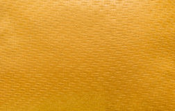 Gold sofa linen fabric texture for background.  Royalty Free Stock Photo