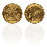 Gold sovereign with reflection. Isolated in white Royalty Free Stock Image