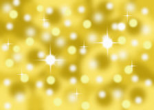 Gold sparkle abstract bokeh background Stock Image