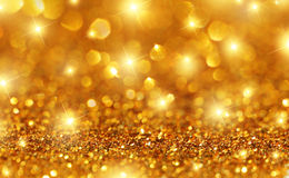Gold Glitter Stars Background. Sparkling gold glitter, stars and bokeh  background Stock Photo