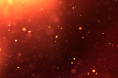 Gold sparkle dust particles flowing background loop seamless ready, golden light spot Royalty Free Stock Photography