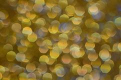 Gold, sparkle, glitter and shine background. Gold, sparkle, glitter and shine. Festive shiny abstract background of textured twinkling yellow gold. Celebrate royalty free stock photography