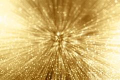 Gold Sparkle Zoom. Gold sparkle background with zoom affect Royalty Free Stock Photo