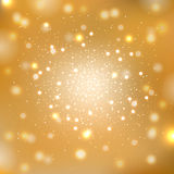 Gold sparkles background Stock Image