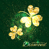 Gold sparkles clover on green background. Two shining glitter glamour flower. Greeting Card with Gold Textured Three Leaf Clover. Patrick Day concept for Stock Image