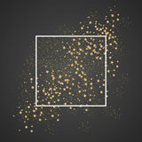 Gold sparkles and stars with white frame on black Stock Images