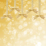 Gold sparkling background with gold ribbon Royalty Free Stock Photography