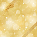 Gold sparkling background with gold ribbon Stock Photo