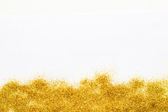 Gold sparkly glitter background at the bottom. Stock Image