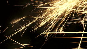 Gold sparks shooting across the frame Stock Image
