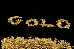 Gold spelled in gold nuggets. The word gold spelled out in gold nuggets Royalty Free Stock Photos