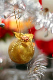 Gold sphere. On a silver fur-tree Stock Image