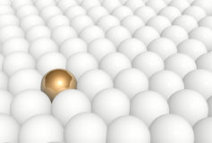 Gold sphere in row of white spheres Stock Images