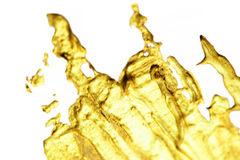 Gold Splash  Abstract hand painted golden stain background with Stock Images