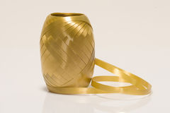 A gold spool of ribbon Royalty Free Stock Photo