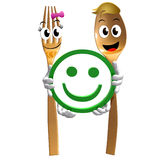 Gold spoon fork with smiley satisfaction sign Royalty Free Stock Photography