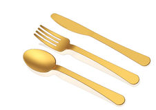 Gold spoon,knife and fork on white background Stock Image