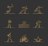 Gold sports icons. Vector line silhouettes of sportsmen. Stock Photo