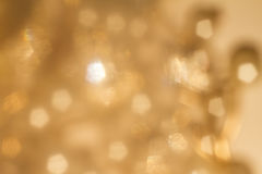 Gold spring or summer background. Elegant abstract background with bokeh defocused lights stock images