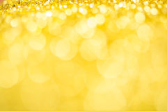 Gold spring or summer, Christmas Glittering background.Holiday a Royalty Free Stock Image