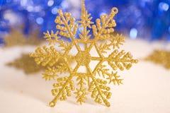 Gold star. Ornamental golden snowflake glod star Royalty Free Stock Photo
