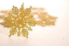 Gold star. Ornamental golden snowflake glod star Stock Photo