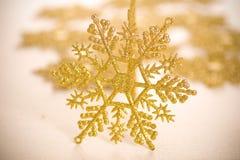 Gold star. Ornamental golden snowflake glod star Royalty Free Stock Photos