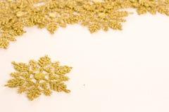 Gold star. Ornamental golden snowflake glod star Stock Photos