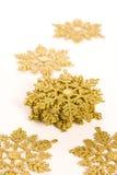 Gold star. Ornamental golden snowflake glod star Royalty Free Stock Images