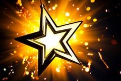 Gold star. Against orange fireworks background Stock Images