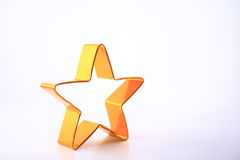 Gold star against white background Stock Photos