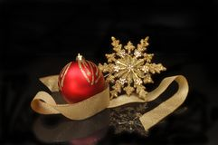 Gold star and bauble decoration stock photography