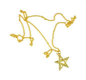 Gold star with chain costume jewelry Royalty Free Stock Photography