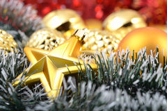 Gold star and Christmas balls Royalty Free Stock Images