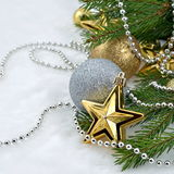 Gold star and Christmas balls. On a spruce branch for decoration stock photo