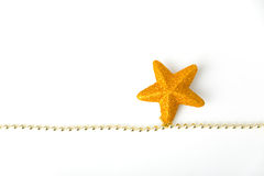 Gold star garland. Gold star with chain as christmas decoration on white background royalty free stock image