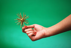 Gold star in hand. Gold christmas star in woman hand Royalty Free Stock Images