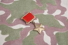 The Gold Star medal is a special insignia that identifies recipients of the title Hero in the Soviet Union on Soviet camouflag Royalty Free Stock Image