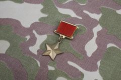 The Gold Star medal is a special insignia that identifies recipients of the title Hero in the Soviet Union on Soviet camouflag Stock Photography