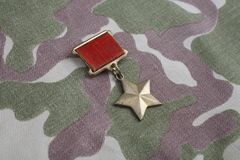 The Gold Star medal is a special insignia that identifies recipients of the title Hero in the Soviet Union on Soviet camouflag Stock Photos