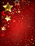 Gold star on a red background Royalty Free Stock Photo