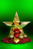 Gold Star and Shiny Ornaments Royalty Free Stock Image